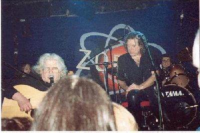 Photo: Tim in performance, with Robert Plant